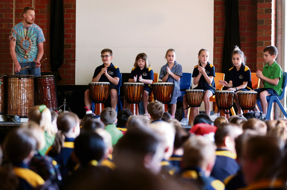 Drumming instructor Aaron Bathols with students. Picture: David Baylis d477698.