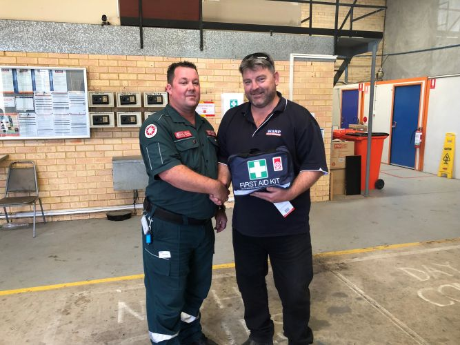 St John Ambulance volunteer ambulance officer Phil Mattaboni with Rick Reid.