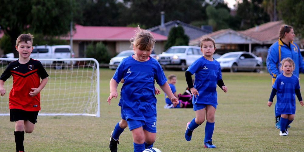Under-6 team member Jasmin Brown playing in the Miniroos Cluster game.