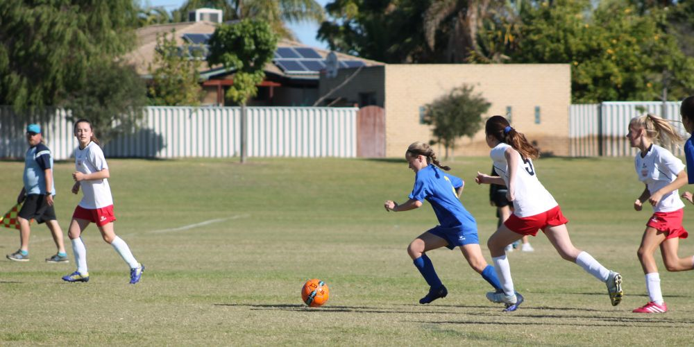 Under-14 Girls League team member Caitlin Martin breaking through midfield with pace.