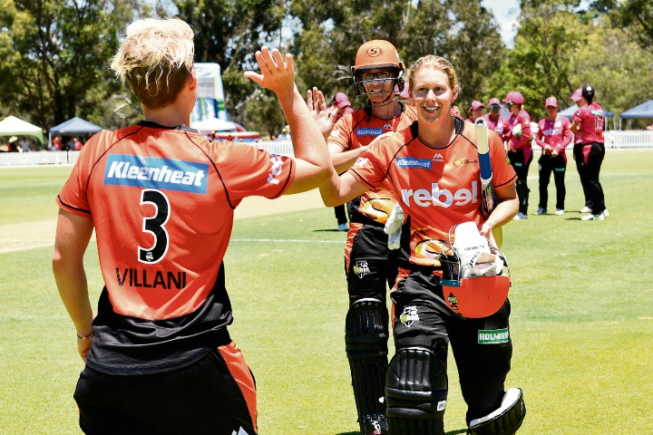 Elyse Villani congratulates Mathilda Carmichael after the Scorchers defeated the Sixers. Picture: Stefan Gosatti/Getty Images