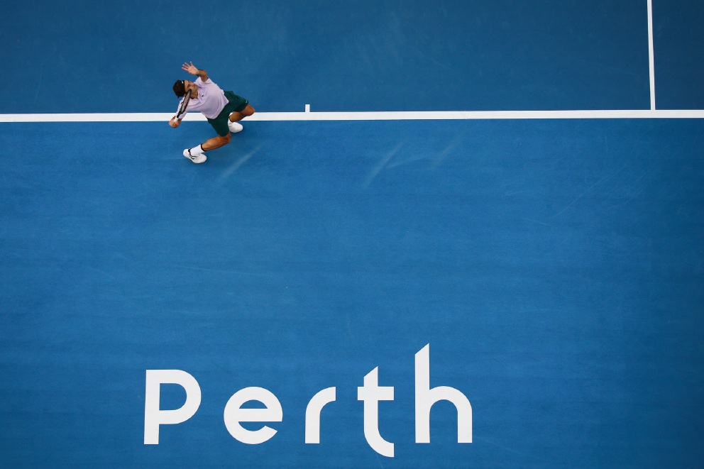 Roger Federer in action against Jack Sock at the Hopman Cup