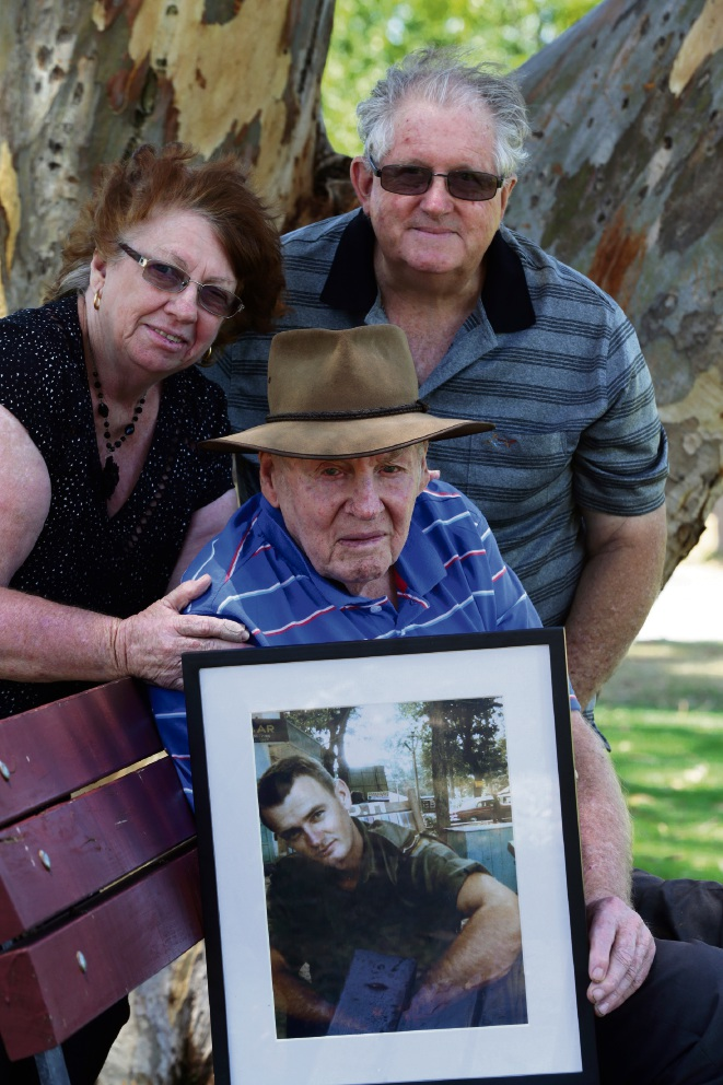 Janet McWhirter (Mandurah) and her partner John Muirhead (Mandurah) and her brother John Bell (Forrestfield) with a picture of Alec Bell. Picture: Martin Kennealey www.communitypix.com.au   d477916
