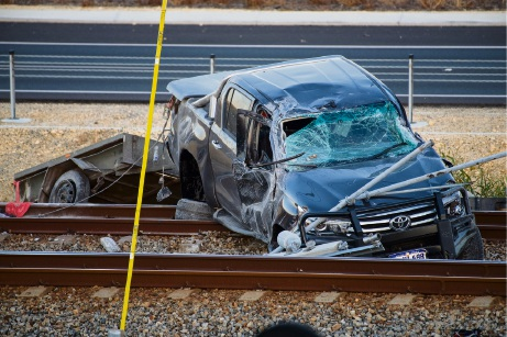 The banged-up ute on the tracks near Currambine station. Pictures: Anthony Mason