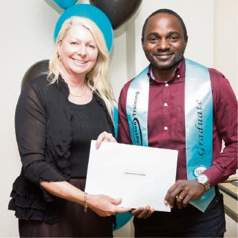 DNA Kingston Training director Susan Lawton presents international student Oluwasegun Olumide with Certificates for the Diploma of Work Health and Safety and Certificate III in Individual Support.