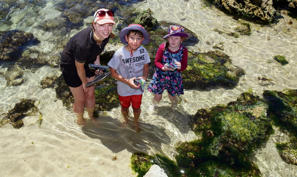 Nearer to Nature education officer Hannah Napier with Aidan Mills (9) and Stella Hicks (7) at Trigg Beach as part of the Nearer to Nature program. Picture: Martin Kennealey.