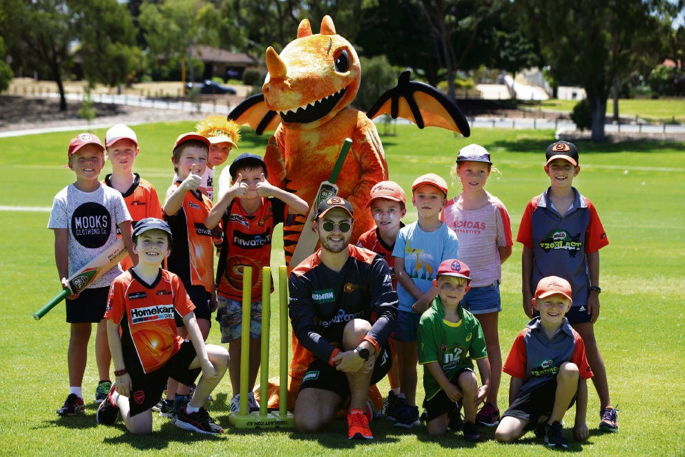 Scorchers player Josh Inglis and mascot Blaze with kids at the School Holiday Bash. Picture: Martin Kennealey d478114