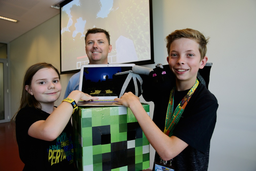 Angelica Kinney (11), Mind Buzz owner Sean Firth and Kye Brindle (12) during a camp in Peppermint Grove.
