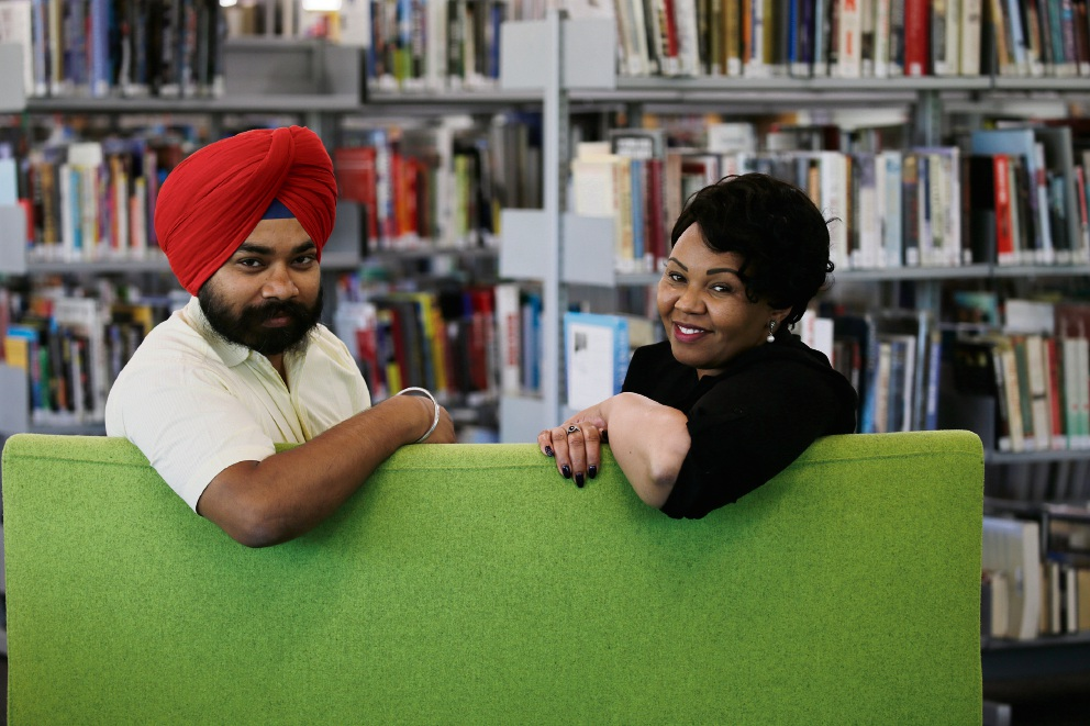 Kaleidoscope project officer Nirmal Singh with multicultural project officer Eva Mwakichako. Picture: Andrew Ritchie www.communitypix.com.au d477938