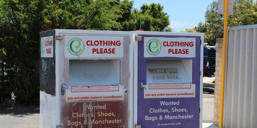 A Scarborough business owner cleaned up items from outside these bins yesterday.