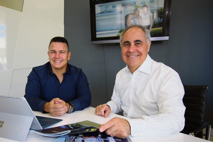 Altitude Real Estate's Paul Tonich (left) and Realmark's John Percudani join forces.