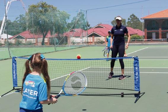 Alicia Molik playing Kalamunda Tennis Club juniors.