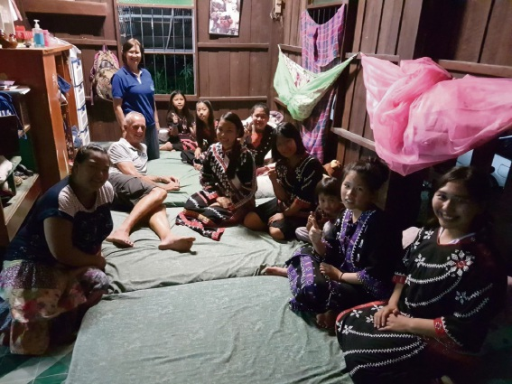 Mill Point Rotary Club member Chris Herrmann and Borderless Friendship WA president Dr Lorel Mayberry at a  Borderless Friendship house in Northern Thailand meeting with orphans on sheets from the Linen Project.