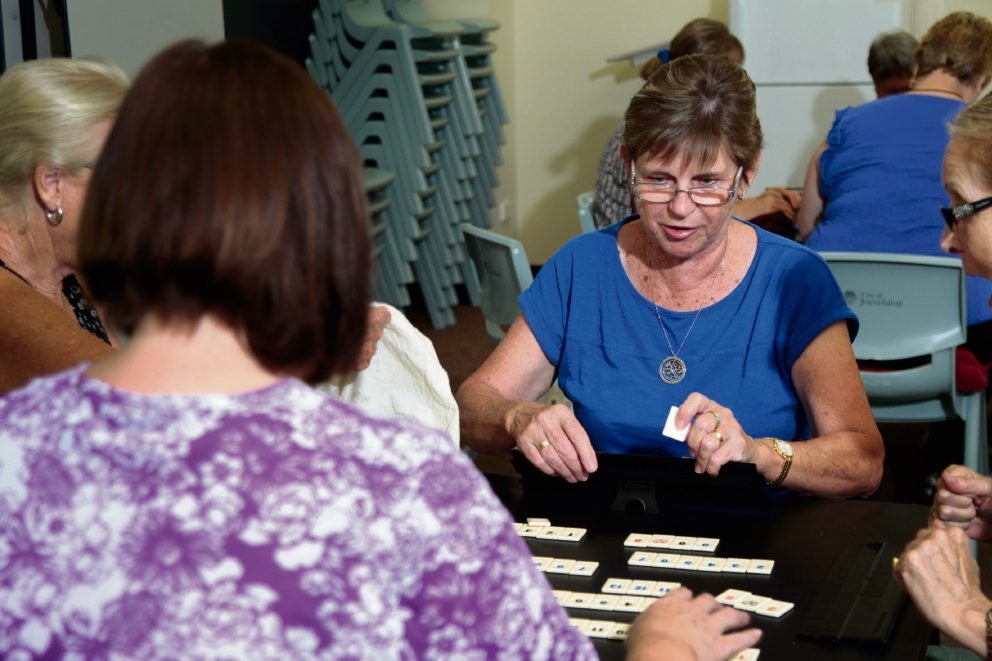 Enjoying a game of Rummikub is Bev Kross (centre) with friends. Picture: Marie Nirme