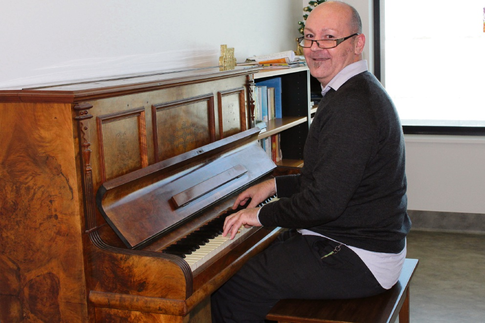 Caregiver Tony DiFlorio playing the piano at Midland Hospital.