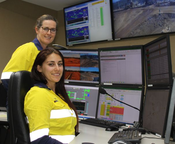 Kellie Tuia (seated) who is learning to become a full time dispatch operator with Yvonne Fahey, initiative co-creator at the Huntley mine.