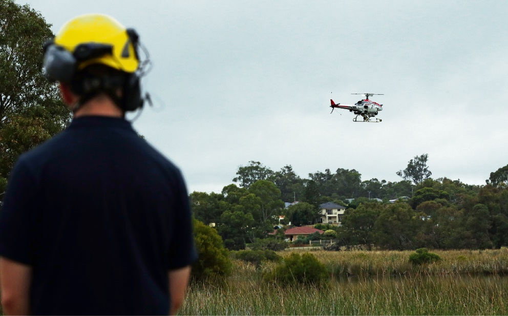 Mitch Grimes (Heliwest) with the R Max. Picture: Martin Kennealey d478404