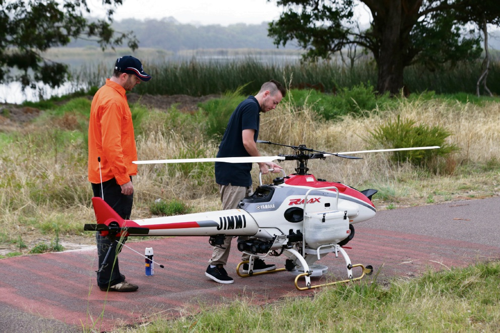 Pilot Brent Love (Yamaha) and Mitch Grimes (Heliwest) with the R Max. Picture: Martin Kennealey d478404