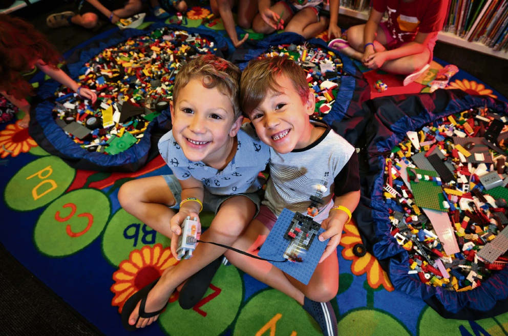 L-R: Luke (6) and Ben (4) Dawes of Bayswater with their Lego creation. Lego Space Adventures are taking place at the Guildford Library during the school holidays.