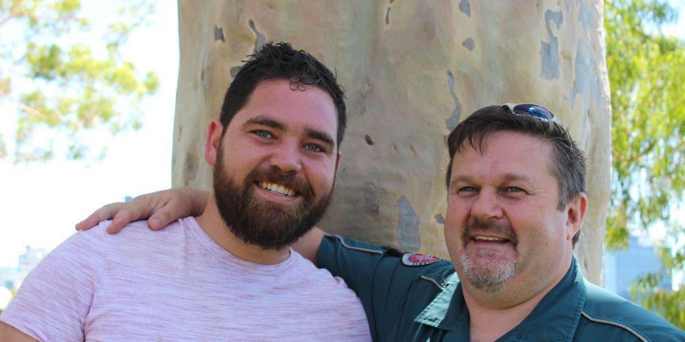 Mat Currie (left) and John McArthur, the paramedic who saved his life after a horrific attack in 2011.