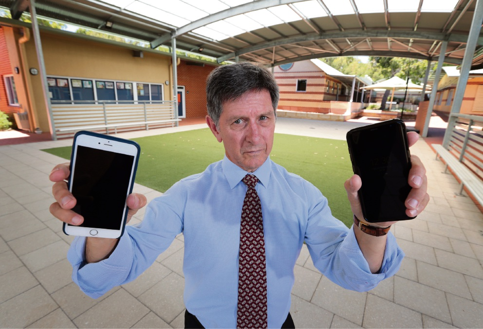 Helena College Principal Ian Lyons will introduce a new student mobile phone use policy at the senior school for 2018. The school feels that mobile phones are too much of a distraction for students during the school day. Photo: David Baylis