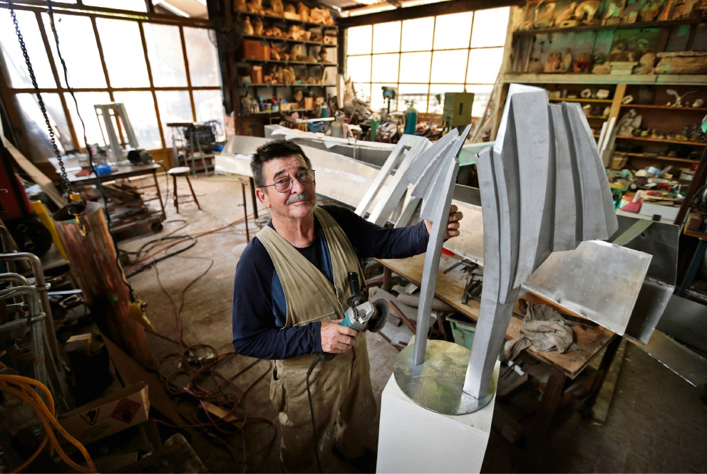 Ron Gomboc of Middle Swan, working on his scale model of his Sculptures by the Sea piece called The Elder. The full size artwork will be 6m tall when finished. Photo: David Baylis