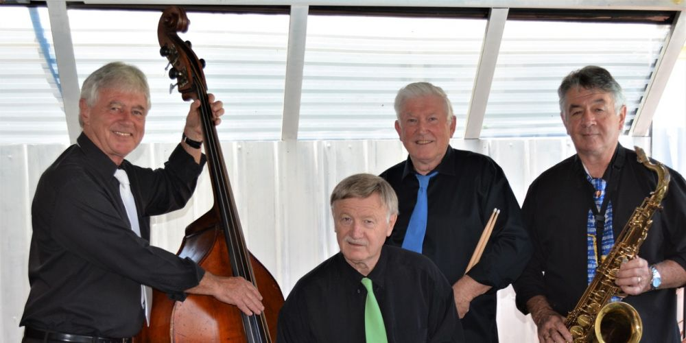 Rhythm Katz. Left to right - John Healy on double bass, Tony Eardley on keys, Nigel Ridgway on drums and Greg Clarke on the sax, trumpet, guitar and lead singer.