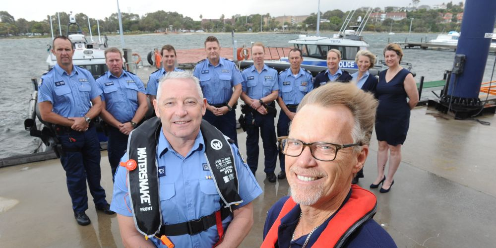 Department of Transport staffer Laurence Adams (front) and Water police want skippers to put safety first on the water during Australia Day.