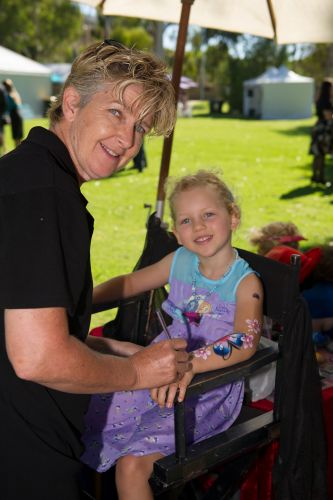 Jessica Dymock (5) having her arm painted by Julie Wiscombe. Pictures: Stewart Allen