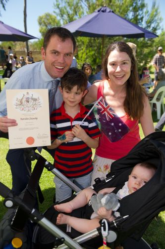 Martin Keer celebrates his citizenship with wife Fiona and children Benjamin (7) and Laura (8 months). Pictures: Stewart Allen
