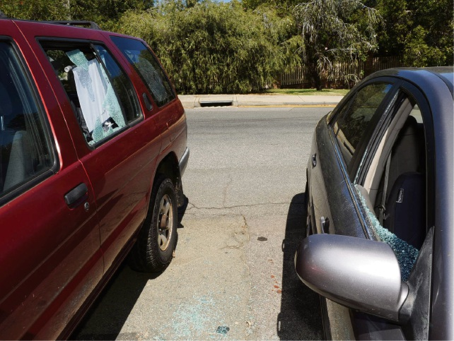 Two of the cars  smashed in Village Place, Mosman Park. Photo: Jon Bassett