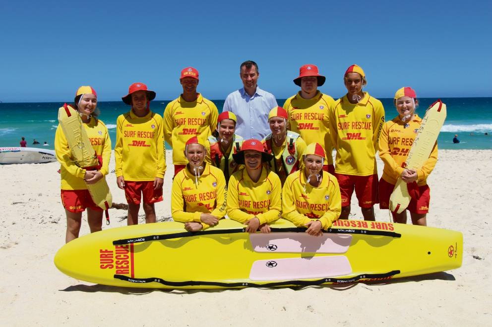 Trigg Island Surf Life Saving Club members with president Shane Bowbridge (standing third from left) and Stirling MHR Michael Keenan.