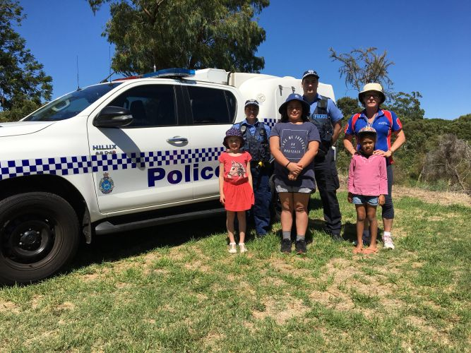 Kensington PCYC Out of School Care Centre attendees Grace Borbely, 7, Larissa Mitchell, 11, and Valleena Robinson, 6, meet with Kensington Police constables Cat McFadyean and Zac Rothnie alongside centre coordinator Mel Scholes.