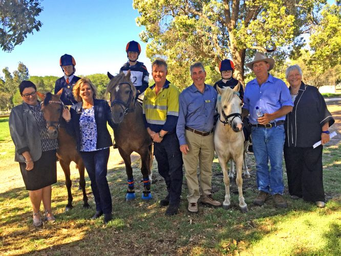 Canning MLA Lisa Baker, Murray MLA Robyn Clarke, Alcoa production manager Tom Duxbury, Murray shire president David Bolt, Murray Equestrian Association vice president Greg Angilley and Peel Development Commission chairman Paddi Creevey with members of Peel Horse and Pony Club.