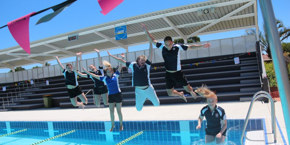 Bayswater Waves staff jump into the refurbished 50m outdoor pool.