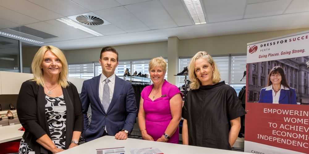 Diane Murfit, Jane McCormack and Karen Woodcock from Dress for Success with JLL's Angelo Amara.