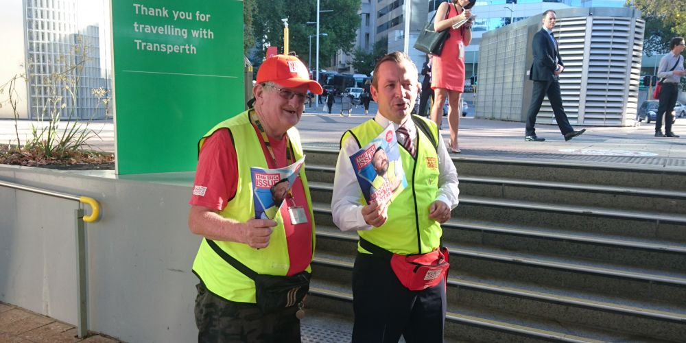 Big Issue vendor Steve and Premier Mark McGowan drum up some business.
