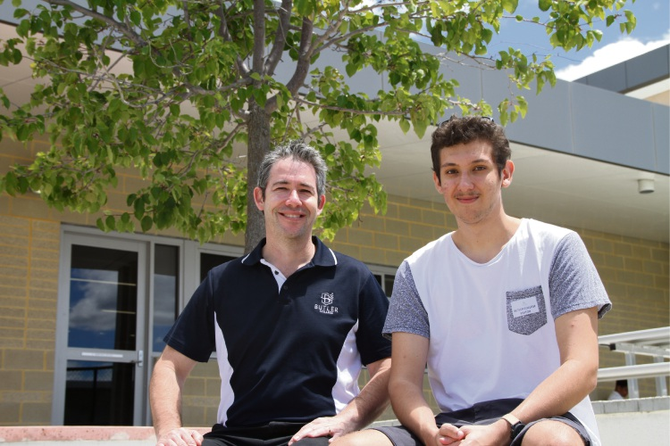 Teacher Kane Pittard with graduate Jason Creasey.