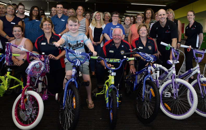 Wheels of progress: Luke Stevens (6) with Lorraine Alvin, Malcolm Gow and Annie Purdy (Lions Club)  Darren Brady and Ashleigh Hourigan (Total Team Building) and teachers. Picture: Martin Kennealey    d478718