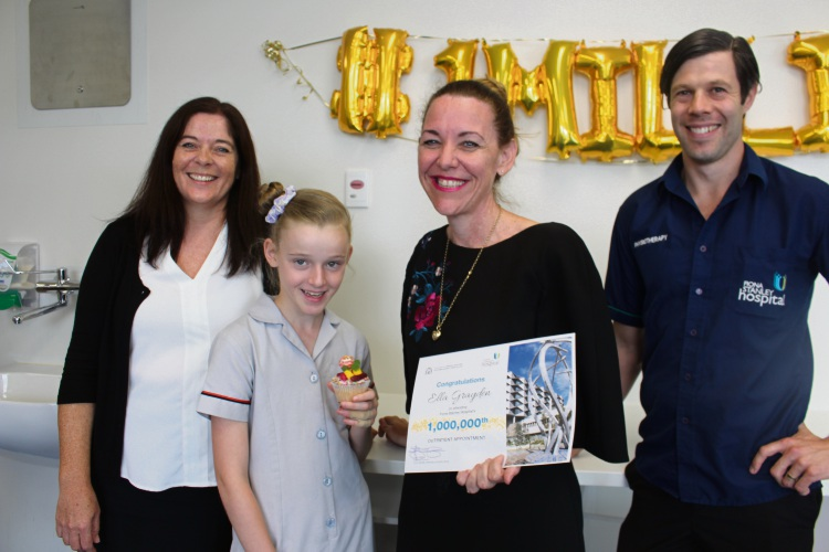 Outpatient manager Karen Tasker, one millionth outpatient Ella Grayden, Fiona Stanley and Fremantle Hospital Group executive director Janet Zagari and senior physiotherapist Curtis Harmer.