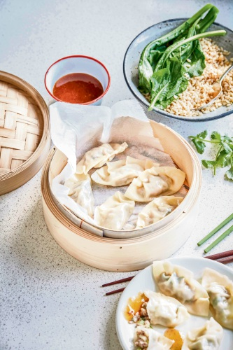 Lamb dumplings with plum sauce.