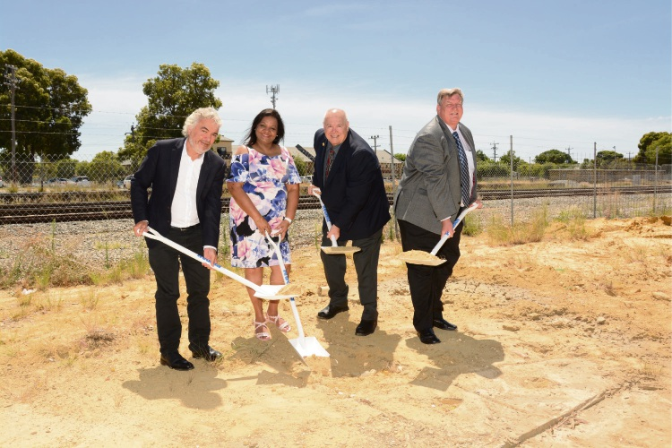 Turning of the first sod by Dr Vasantha Preetham,  Kieran Kinsella, Councillor David Lucas, and architect Kevin Palassis.