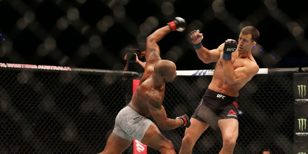Yoel Romero throws a punch at Luke Rockhold at the UFC221 middleweight main event at Perth Arena. Picture: Andrew Ritchie