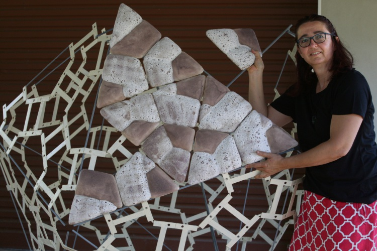 Andrea Vinkovic works on her piece Seed. Picture: Bruce Hunt d478683