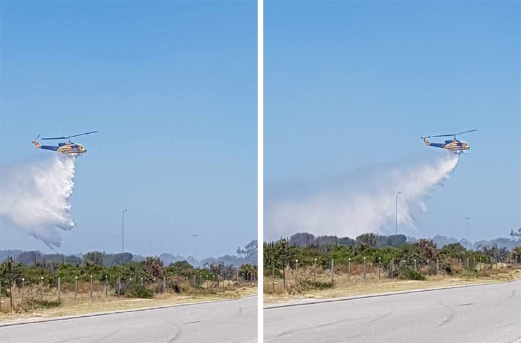 A helicopter drops water on the Port Kennedy fire. Pictures: Gabrielle Jeffery.