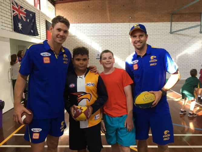 West Coast Eagles players Jack Redden (left) and Mark LeCras (right) with Chad Sullivan (13) and Vincent Rose (12) at Kensington PCYC.