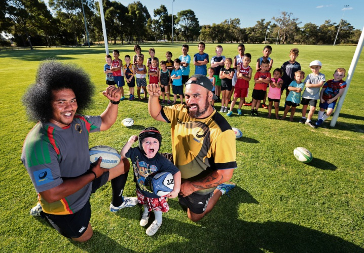 Front: Lemoto Manukeu (Captain, Swan Suburbs Rugby Union Football Club), Nigel Bonner and Kehu Kingi (President, Swan Suburbs Rugby Union Football Club), surrounded by members of the club. The club is on the hunt for sponsors so disadvantaged kids can play the sport for free this season. Picture: David Baylis d479201