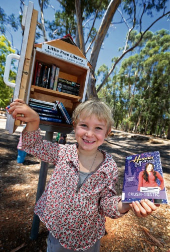 Marlena Lieb (5) of Gidgegannup using the new little library in the Sculpture Park. Picture: David Baylis.