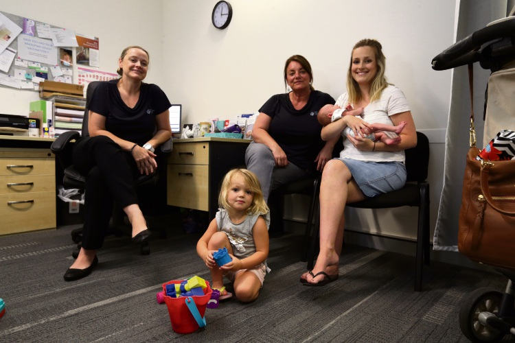 Midwives Linda Wilson and Gaynor Ward with Lissette Hardwick (Butler) and her children Jaime (2) and Oliver. Picture: David Baylis.
