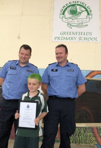 CAPS (479629p): Senior Constable Russell Lindquist and Sergeant Jamie Raper with Taj Agnew (7) at Greenfields Primary School on crazy hair day.